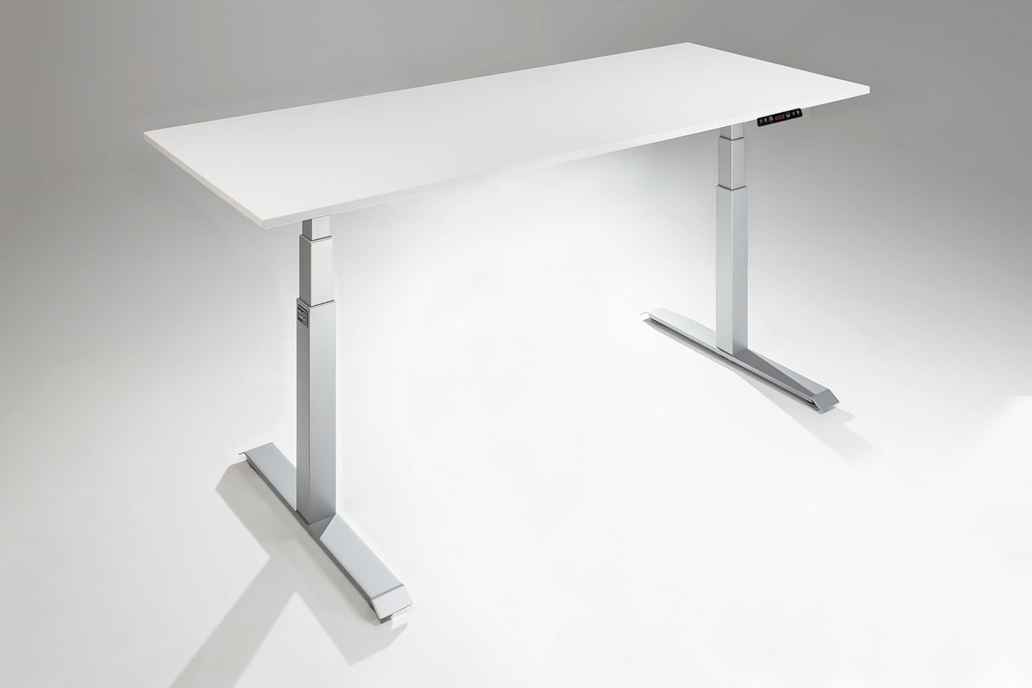 Mod E Pro Height Adjustable Standing Desk Silver Base White Table Top Angled